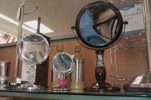 Self-portrait taken in a public distorting bathroom mirror