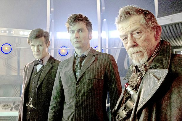 Three Doctor Whos standing together