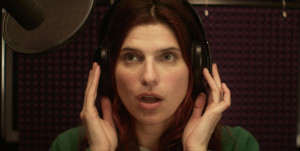 Lake Bell speaks into a microphone