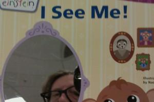 Self-portrait taken in a mirror on a children's book