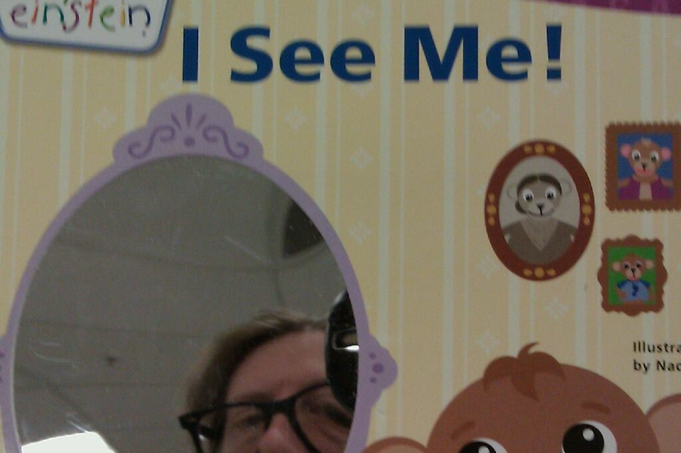Self-portrait taken in a mirror on a children's book