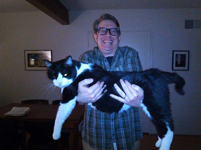 Man holding enormous cat